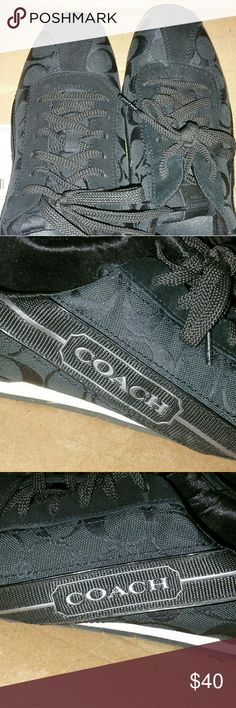 Coach sneakers. Black with a silver strip. Barely worn...still in great condition! They hurt my feet, that's why I hardly wore them. My loss is your gain. 9.5 medium Coach Shoes Sneakers