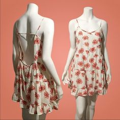 """Romeo & Juliet Floral-Print Dress This floral print dress with ruffle hem is an easy and breezy style this summer. Spaghetti strap. Low back. Relaxed style. Unlined. 100% polyester. Approx. total length 33"""". Made with love in the USA Dresses"""