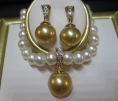 Royal Tahitian Pearls | Booth 509 | January 2014 http://royaltahitianpearls.com/ http://www.californiagiftshow.com/ Go for the Gold in this  stunning original design: Diamond Royalty Set, 14k gold with diamonds on the enhancer and the earrings. Natural color and shape South Sea Golden pearls shown, can be created with Tahitian pearls. Gorgeous, just like you!