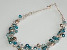 Bronze and Blue crochet wire necklace w/ Swarovski Pearls. $45.00, via Etsy.