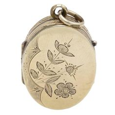 Engraved Floral Locket with Daisy and Lily | From a unique collection of vintage pendant necklaces at https://www.1stdibs.com/jewelry/necklaces/pendant-necklaces/