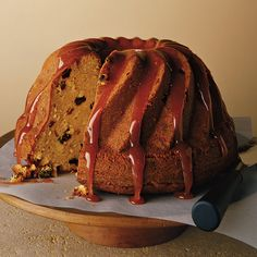Dark rum is lavishly used in a coconut Bundt cake; raisins, plump from soaking in the liquor, are mixed into the batter, and a sweet sticky glaze is drizzled on top.