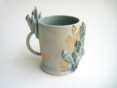 RESERVED FOR SAM Sculpted Gem Growing by SilverLiningCeramics, $56.00 The most asinus improbus teacup ever.