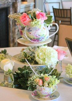 A gorgeous floral centerpiece at this Romantic Tea Party themed Bridal Shower! See more party ideas at CatchMyParty.com