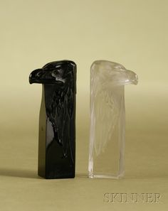 Two René Lalique Glass Wax Seals, 20th century, one colorless glass, with incised signature R. Lalique, France, and numbered N:175, the other black glass, signed R. Lalique, both in the form of an eagle's head with rectangular base, plain sealing surface
