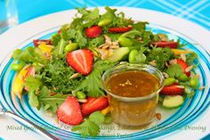 Mixed Green Salad w/ Strawberries, Mango, Edamame & Honey-Lime Dressing (could use lemon juice, I suppose, if you don't like the vinegar taste)