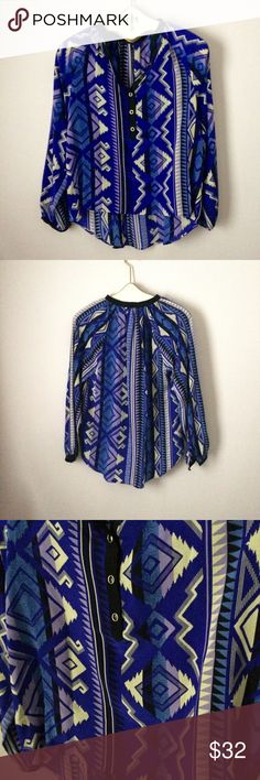 Yumi Kim 100% silk top Yumi Kim 100% silk top. Semi sheer. Beautiful cobalt blue with purple and cream design. Buttons quarter of the way up. High/low cut. Perfect with leggings or a skirt! Size small Yumi Kim Tops