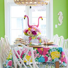 "Lilli Pulitzer-Inspired Luncheon | Where to Splurge | Custom tablecloths made of Lilly Pulitzer fabric. ""I always have them made unlined so I can reuse the fabric for throw pillows later,"" she says. ""I'm also constantly on the hunt for unusual vintage pieces that I can use in a party setting, such as this bar cart [below]. A fresh coat of bright paint gives it an easy update."""