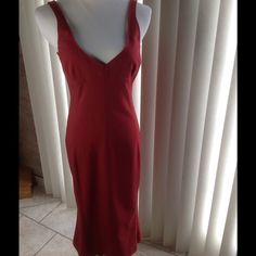 D & G Dress Authentic D & G dress, classic elegance, simple lines, plunging neckline and rounded back. Beautiful dark red color. Slight trumpet style skirt.  Not a straight skirt. Measurements laying flat: Bust 17 inches, Waist 15 inches, Hips 18 inches, Length 42 inches D&G Dresses