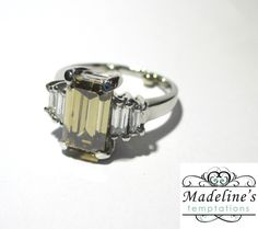 Platinum ring set with one Fancy Brown Diamond Emerald cut and four smaller baguettes. Platinum Ring, Emerald Cut Diamonds, Bracelet Watch, Bands, Wedding Rings, Engagement Rings, Brown, Bracelets, Accessories