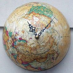 Love the idea of using an old globe and making a clock out of it.