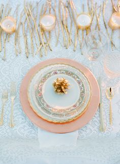 Add a rose gold charger behind all china to make mixed china more uniform. Use rose gold silverware.