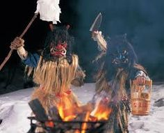 Namahage, played by young men in domenic masks and traditional straw garments, make the rounds of houses in their villages. They burst into these houses searching for new community members such as young wives and children.    In an inimitable throaty scream, the Namahage encourage and order these newcomers to work and study hard, and obey their parents or in-laws.  Akita, JAPAN. New Community, Study Hard, Young Men, Akita, Scream, Searching, Masks, Parents, Houses