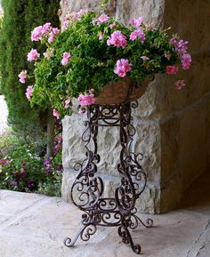 Love the wrought iron flower stand