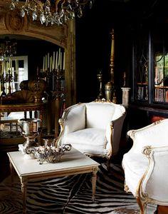 dark walls, zebra rug & white chairs