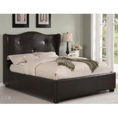 Tufted, wingback headboard. with this style i would never hit my leg into the bed frame like i do now !lol