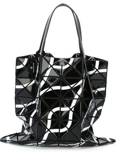 Shop Bao Bao Issey Miyake 'Tokolo' tote in H. Lorenzo from the world's best independent boutiques at farfetch.com. Shop 300 boutiques at one address.