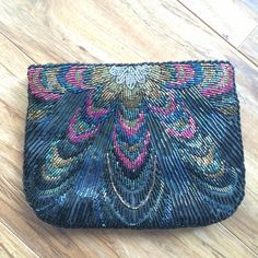 Vintage Beaded Zipper Clutch Beaded on both sides. Zipper closure. Small pocket inside. See last photo for measurements. Perfect condition, no missing beads. Vintage Bags Clutches & Wristlets