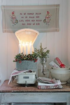 Charming Christmas Decorations with evergreen berries and vintage red and white linens. And the ADVENT candles too!