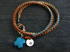 We love turquoise and leather any day. Wrap those leather crystals on to the leather with some sunshine yellow lashing and you have a great double wrist wrap! Charms on the clasp are a turquoise cross and a Fleur de Lis stamp. $28.00 http://www.latherandlace.com/happy-color-wrap-around-bracelet/