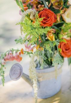Yes to flowers in rustic watering cans // Honey Gem Creative