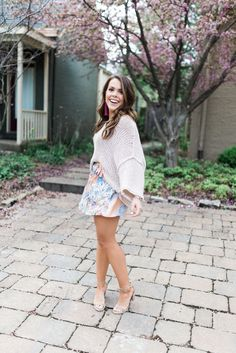 Spring Outfit Inspiration via Glitter & Gingham // Free People Skort, Free People Sweater, Gigi New York Crossbody, Tassel Earrings // How to wear a summer sweater
