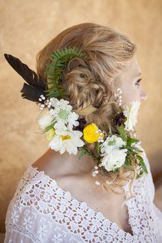 flowers braided into the hair, photo by Buena Lane, flowers by Lilify http://ruffledblog.com/western-nomadic-styled-shoot #hair #bridal #flowers