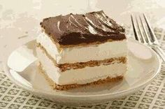 Our Graham Cracker Eclair Cake is a spectacular no-bake dessert recipe - no oven required and no baking skills required! Just mix, layer and chill - then serve up a delectable dessert for a crowd! Eclair Cake Recipes, Pudding Desserts, No Bake Desserts, Easy Desserts, Delicious Desserts, Dessert Recipes, Vanilla Pudding Recipes, Eclair Recipe, Pudding Cake