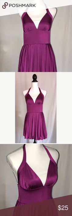 "Berry Magenta Stretch Bubble Halter Mini Dress L Stretchy Halter dress with strap around neck.  Elastic along the top of back.  Bubble skirt is gathered with elastic underneath.   Some shimmer in fabric.  Size Large. Pit to pit laying flat 13.75"", length approx 29"".  In excellent condition.   Tag says Large. Best fits Juniors Large or women's medium.  Please check measurements carefully before buying. Born in Hollywood Dresses Mini"