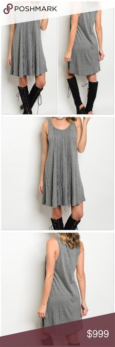 Coming Grey  Soon scoop neck jersey tunic dress. Gray Sleeveless scoop neck jersey tunic dress.   Fabric Content: 50% POLYESTER 40% COTTON 10% RAYON Size Scale: S-M-L Dresses
