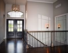 Entry to The Jefferson! Entry Lighting, Mirrored Entry, Reverse Floorplan, Glass Double Doors, Dark Hardwood