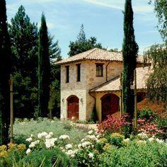 Stone & Stucco - Italian style | mix of Italian cypress trees + cottage style gardens