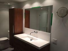 Single sink bathroom wall mirror that is rectangular.
