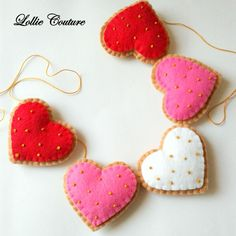 Modern Valentine Garland  MODERN HOLIDAY by Lollie Couture MADE IN THE USA  Modern Valentines Day Heart Cookie Garland designed to add elegance and rich style to your Holidays!  Child SAFE, no beads, ALL hand embroidery with pretty gold french knot sprinkles.   Adjustable for small or larger display, simply space the cookies out or gather them together. Generous 62 long premium gold embroidery string, with loops on each end to hang. Hearts are aprox. 3 1/2 tall by 3 1/2 wide with pr...