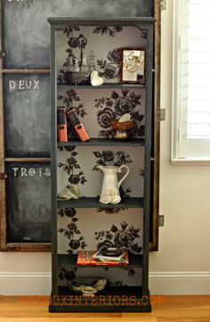 Wallpapered bookcase - good idea for crappy target bookcases