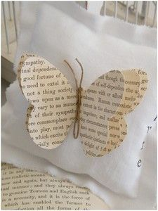 Butterfly from book pages. So pretty, but I don't know if I would want to cut up any of my books in order to make it!