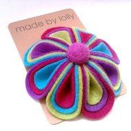 CUSTOM ORDER FOR DINAH This  brooch has been made from four different colours of vibrant  felt which has been crafted into 8 individual petals - each of which feature three different colours! It has been decorated with a contrasting felt ball. Measurin...