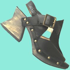 John Fluevog Ask Response clog sandal. T-strap with adjustable buckle.Wooden chunky stylized high heel and platform. John Fluevog, Wooden Clogs, Clog Sandals, T Strap, Mary Janes, Goth, High Heels, Casual, Leather