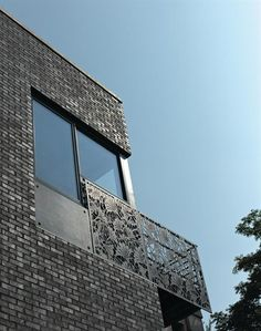 The buildings exterior is highlighted by glazed metallic brick and Cor-Ten steel panels with ginkgo leaf cutouts adapted from a traditional Japanese paper carving (http://www.pinterest.com/AnkAdesign/design-details)