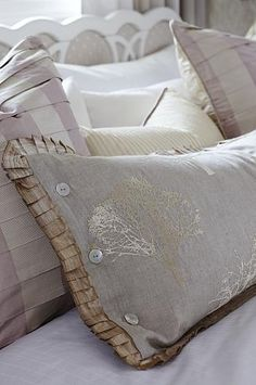 Pleated pillow theme -- knife-edge pleat on front and extra detail on pillow in foreground; full pleats on striped pillows behind