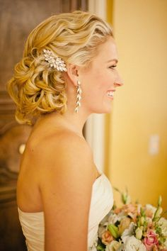 Bridal Hair - 25 Wedding Upstyles & Updo's - Styled waves tied at the nape of the neck and adorned with a beautiful hair brooch makes this a perfect elegant look. #hair #style #upstyle #updo #wedding