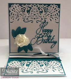 Marie Jones - Die'sire Edge'ables Marseille - Kimono Peacock Feathers embossing folder - Sara Davies Butterfly Lullaby Happy Birthday die - Centura Pearl Hint of Silver - Turquoise card - Spray & Sparkle Pearl Diamond - Collall All Purpose & Tacky glue - White glitter card, ribbon, paper rose - #crafterscompanion