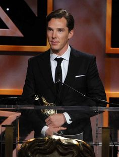 Then there was the time he was so proud to have won an award that he clutched it close to his suit and stared into the distance with his beautiful eyes. | 18 Times Benedict Cumberbatch Looked Like An Absolute GOD In A Suit