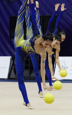 The Japanese team in action during competition of FIG Rhythmic Gymnastics World Cup in Penza on April 2012 in Penza, Russia. Figure Skating Competition Dresses, Gymnastics World, Gymnastics Photography, Rhythmic Gymnastics Leotards, Figure Skating Dresses, Flexibility Workout, Exercise For Kids, Dance Outfits, Fit Women