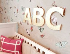 Gorgeous nursery. Golden letters with butterfly wallpaper.
