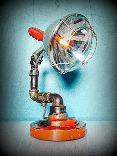 Piping Searchlight Rustic Vintage Lamp - Desk Lamps -  This Rustic Vintage Lamp, Piping Searchlight, is unique, impossible to duplicate piece of steampunk functional art, this light will be perfect for your desk, end …    Read More »  #Desklamp #Handmadelighting #Lamp #Led #Lightbulb #Lighting #Lightingdesign #Metallic #Recycle #Rusticlighting #Steampunk #Tablelamp #Vintagelighting