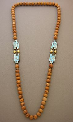 Created by Ruth Frank |  Beautiful lightweight antique Chinese cloisonne amulets are combined  with antique horn beads from the necklace of a Buddhist monk. No clasp,  since it fits comfortably over your head. |  Dorje Designs | SOLD