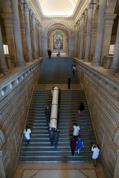 "Get a behind-the-scenes peek at what it takes to hang one enormous tapestry in this blog post. | The tapestry is carried up the large staircase just inside the Museum's Great Hall in preparation for the exhibition, ""Grand Design: Pieter Coecke van Aelst and Renaissance Tapestry,"" on view October 8, 2014–January 11, 2015. #tapestrytuesday #granddesign"