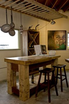 love the ladder to hang pots and pans above the island in kitchen and the island! and the stools!