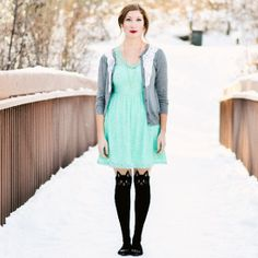 A sweet lace mint dress and cardigan are paired with cat tights for a cute and quirky outfit.